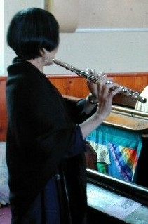 Siew-Yue playing the flute